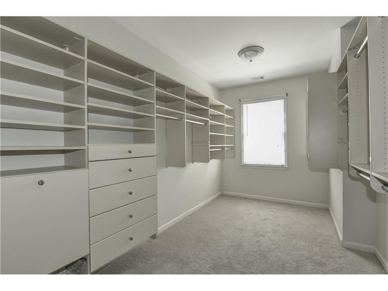 Expansive walk in closet with sturdy built ins for the Master bedroom