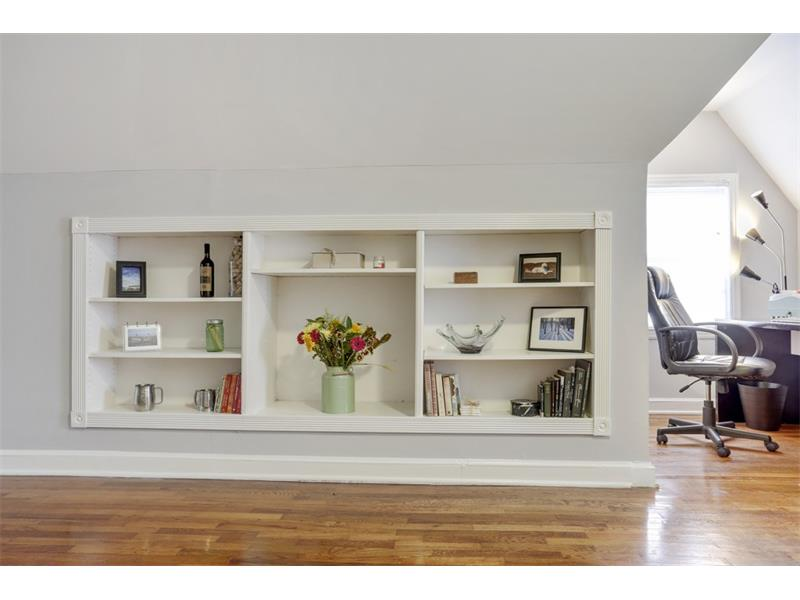 Built-in bookcases on the upstairs level.