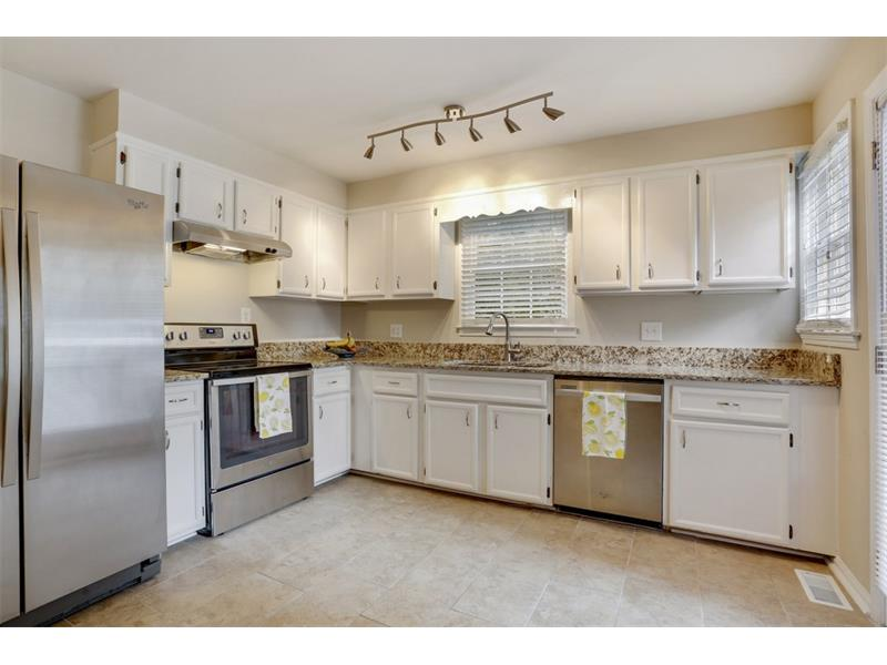 FABULOUS kitchen has granite countertops and stainless steel appliances!