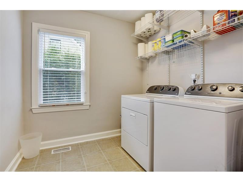Separate, extra large laundry room.