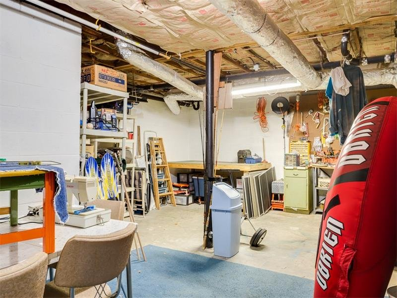 Large unfinished basement area great for workroom and storage