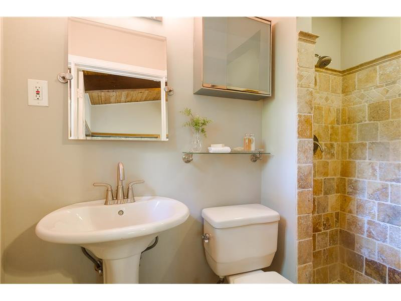 Updated master bath with beautiful neutral tile shower.