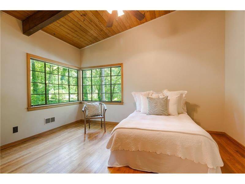 STUNNING 2nd bedroom on main level with loads of natural light, tons of closet space and beautiful vaulted ceiling.