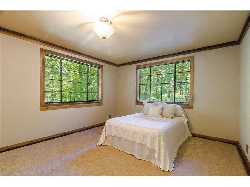 FABULOUS terrace level 3rd bedroom with new carpet and tons of natural light.