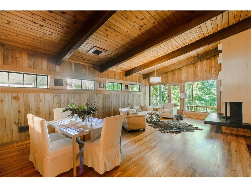 BEST SPACE EVER!  Gorgeous open living and dining room with tons of windows and stunning floor to ceiling natural wood.  Don't forget the fabulous fireplace!
