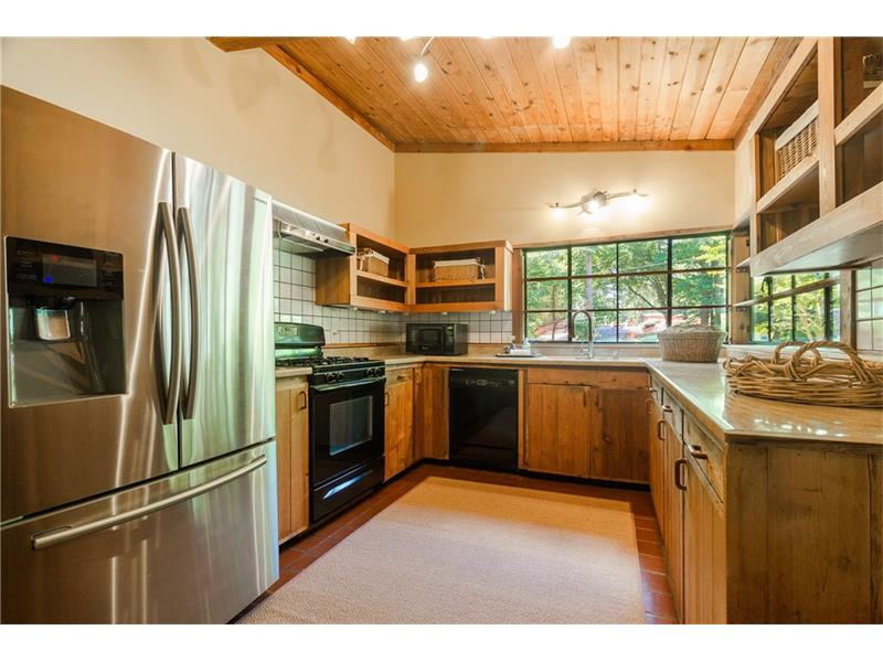 Such an inviting kitchen with loads of sunlight plus a large view to the living and dining room.  You will also LOVE the ease of entering the kitchen from the carport ESPECIALLY on grocery day.