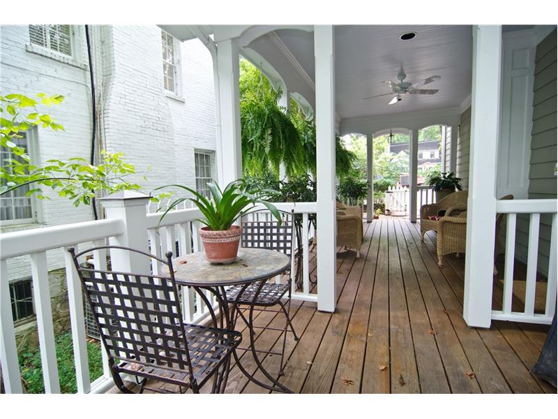 The porch is perfect for grilling out.