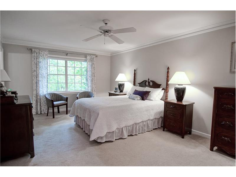 The master bedroom has a sitting area and ensuite bath.