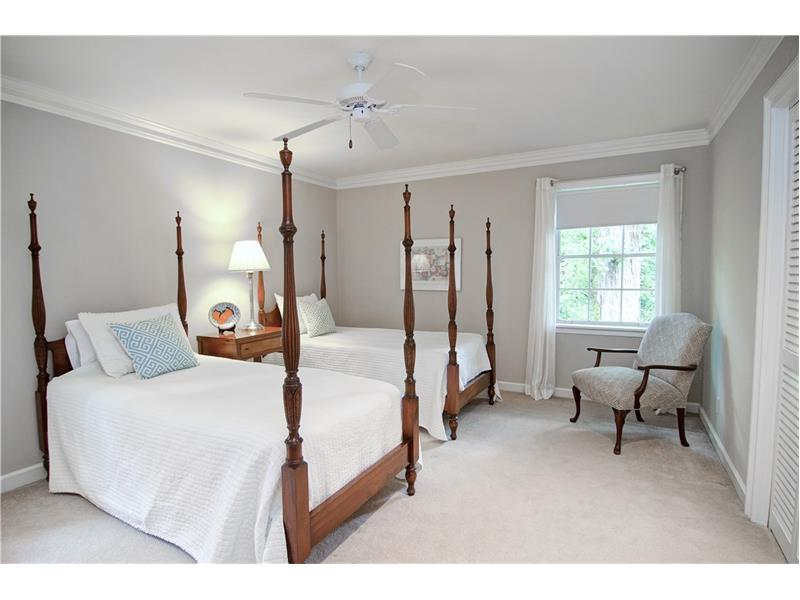 The four bedrooms upstairs have carpet over hardwoods.