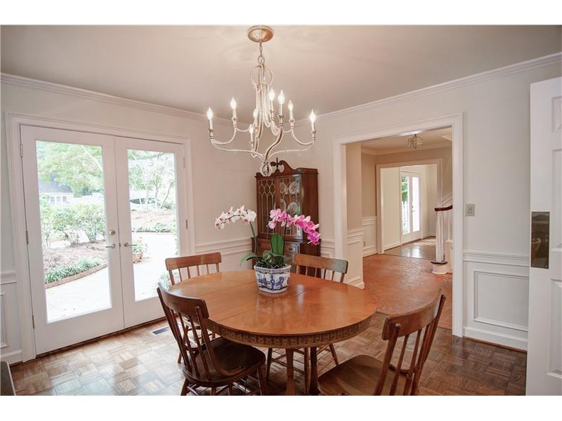 The spacious dining room opens to the patio with french doors.
