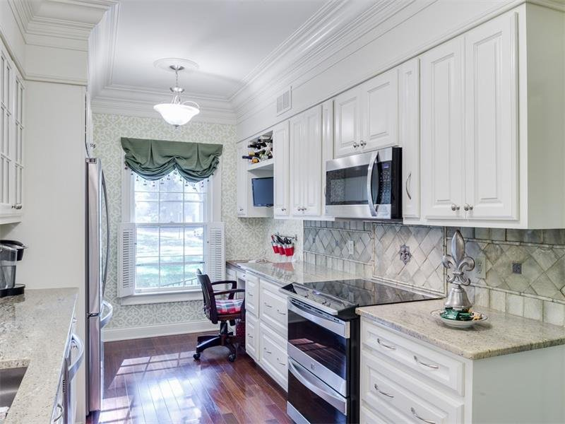 Renovated kitchen with Brazilian granite, desk area stainless appliances.