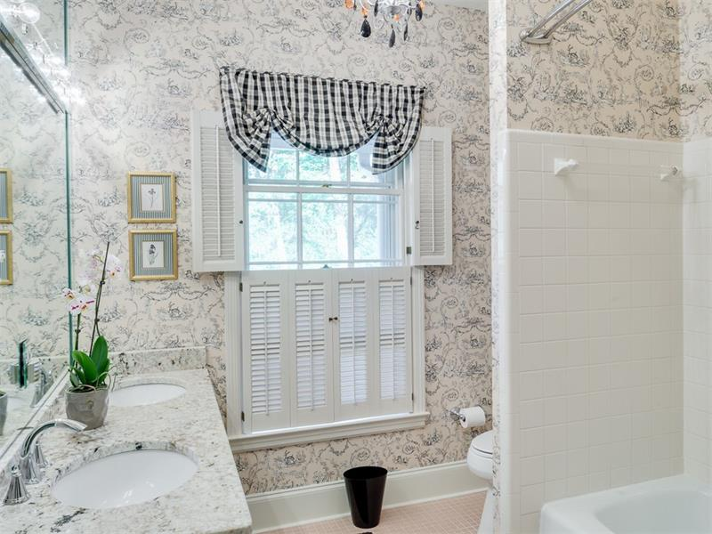 Master bath with double vanities, tub and shower combo. Elegant granite counter tops