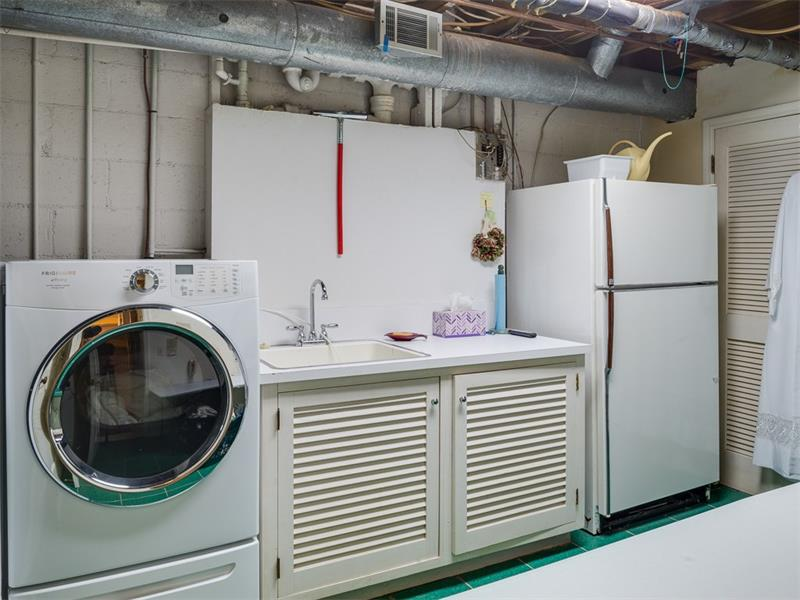 Spacious laundry room on lower level.