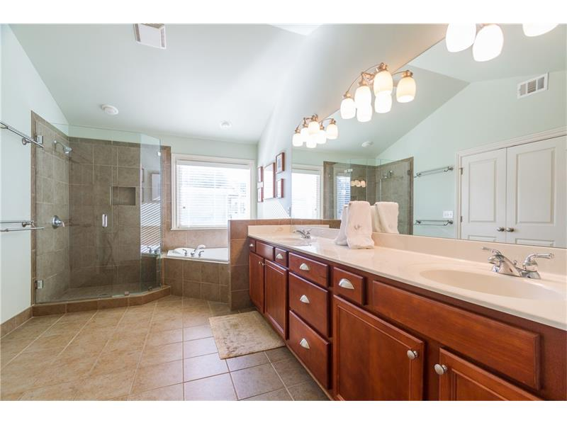 Master Bathroom includes separate tub and double vanities.