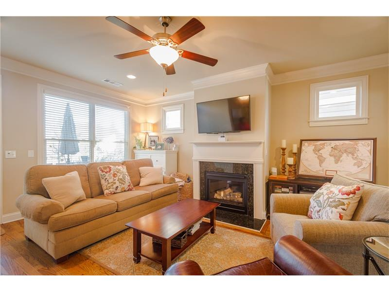 Family room off of the kitchen with gas fireplace.