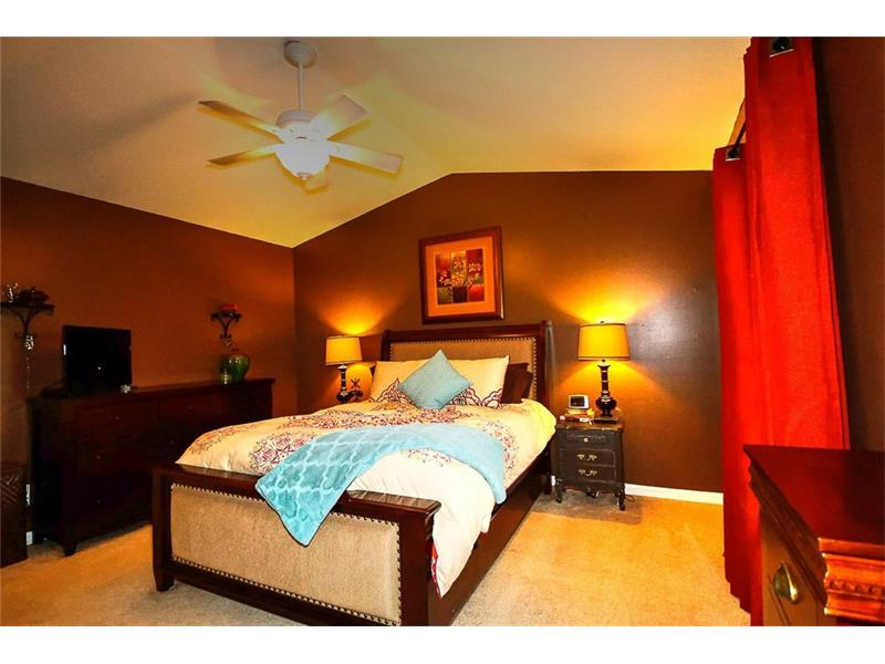 Secluded master bedroom suite with raised ceilings!