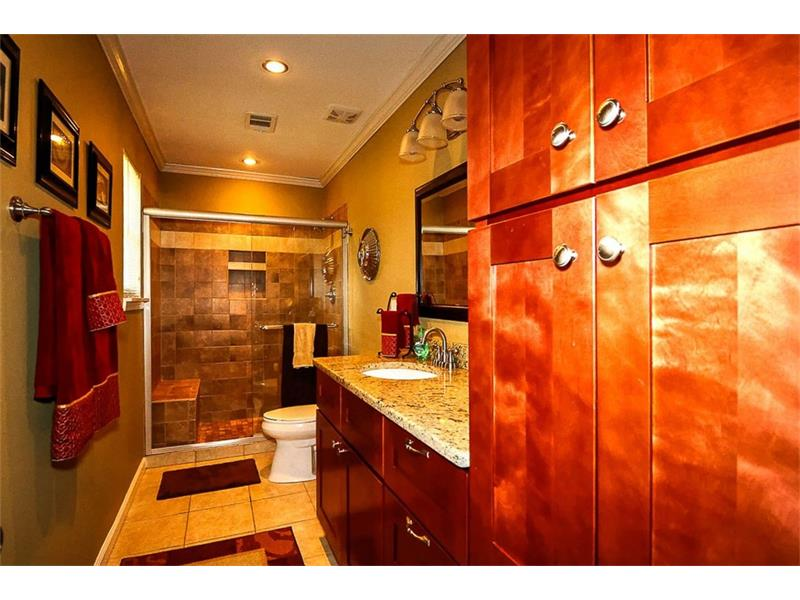 Both bathrooms completely renovated with new cabinets, granite and tile.
