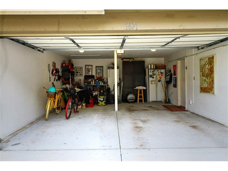 Large two car garage - refrigerator and cabinets to stay!