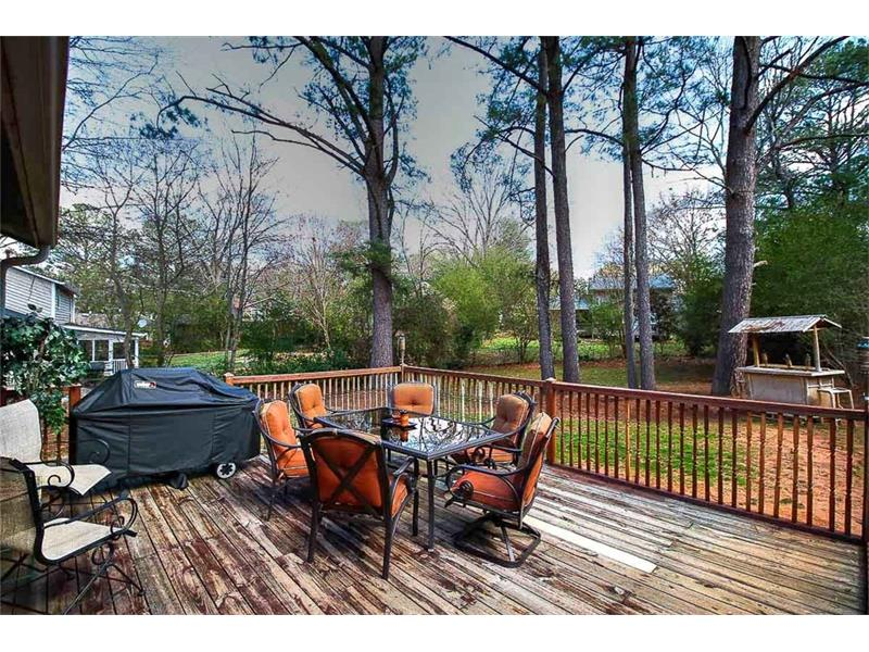 Large entertainers deck overlooks the huge, flat yard.