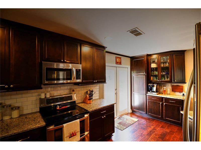 Kitchen renovated down to the studs - new cabinets, granite counters, stainless appliances and direct access to the deck.