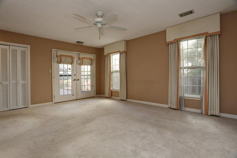 Bright and spacious master bedroom that leads to your private patio!