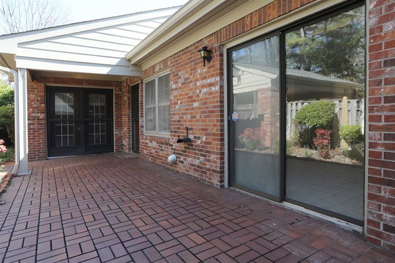 Private brick patio w/ step-less entry.