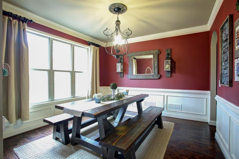 Southern Living at it's best with the custom made farmhouse table & chandelier! Oversized dining room can easily accommodate 12 guests!