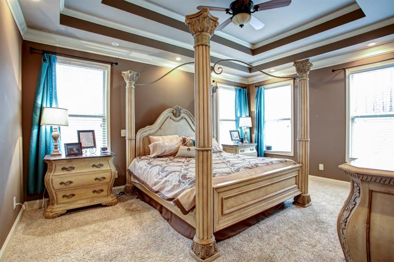 Beautiful double trey ceiling are a gorgeous accent to the master suite. The king bed & bedroom suit also make a statement!