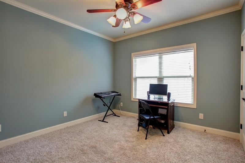 Oversized spare bedroom on main level with walk-in closet!