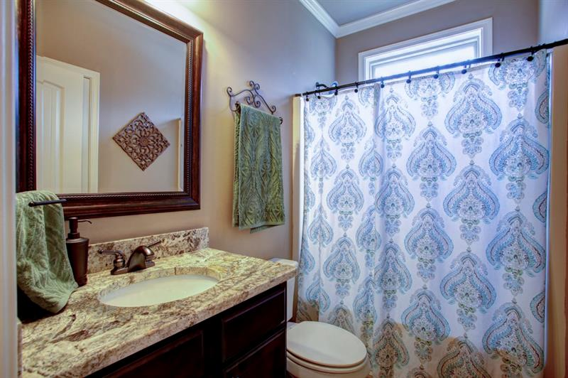 Full bath on main level with natural light, granite countertops & upgraded fixtures!