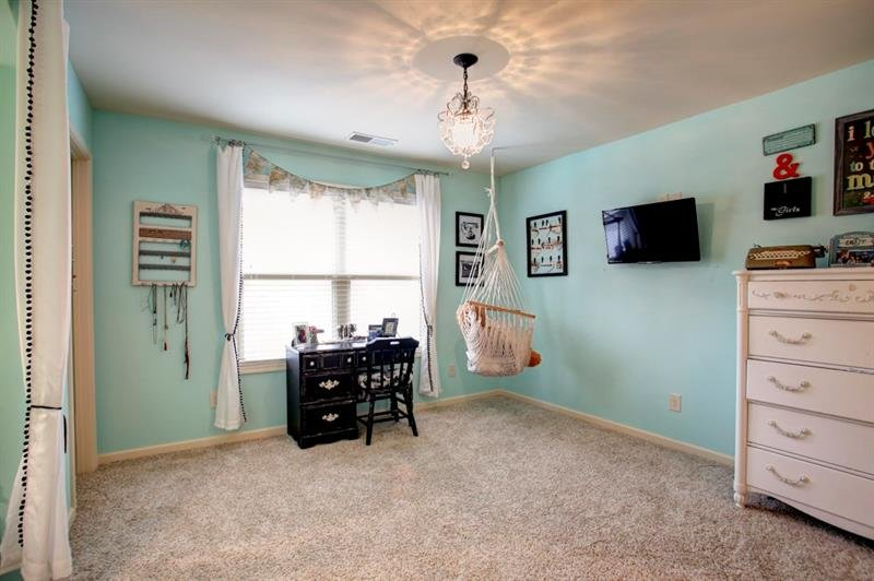 1 of 2 oversized spare bedrooms upstairs. Custom chandelier make this room perfect for a little girl or teen!