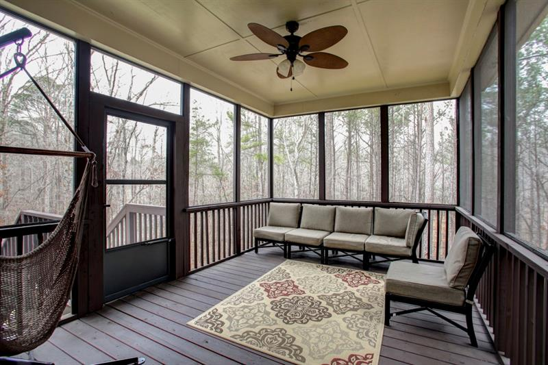Stunning, oversized screened in porch is perfect for sipping morning coffee & listening to the birds!
