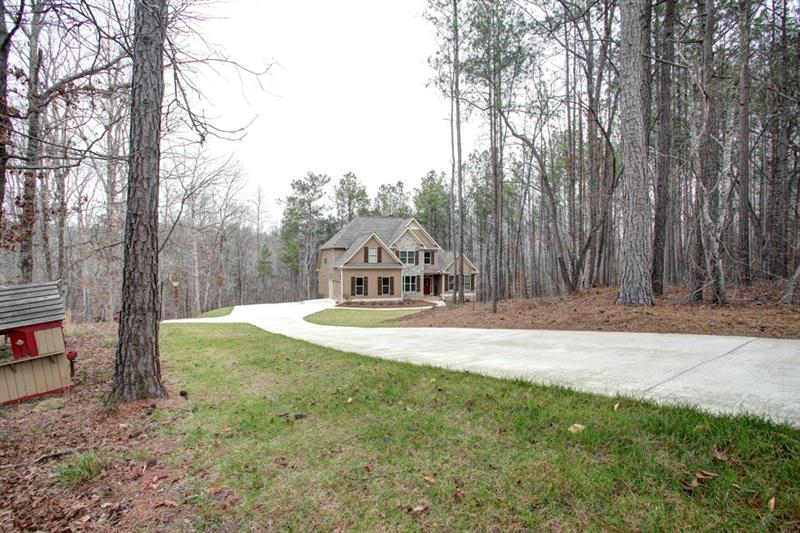 Privacy, privacy, privacy! This home sits on a quiet street & in the middle of 3.35acres!