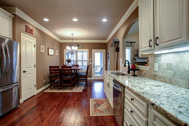Upgraded granite countertops, cabinet pulls/handles, faucets & light fixtures accent this stunning kitchen!