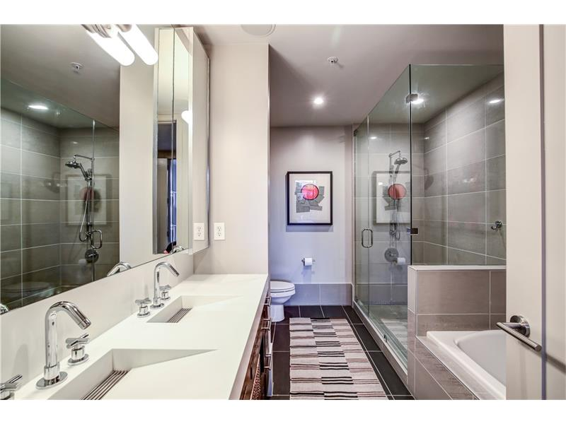 Master bathroom with shower, soaking tub, and double vanities.