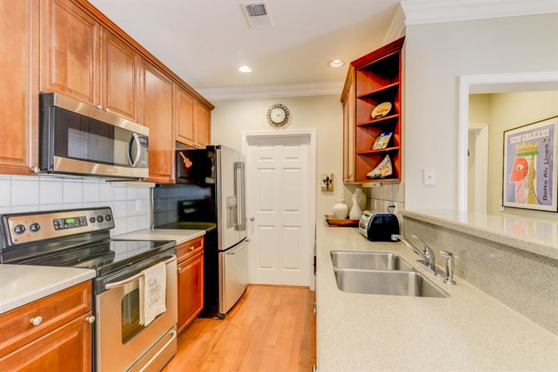 Abundant counter space & kitchen cabinets. The door leads to the laundry/utility room. W/D to remain with the unit.