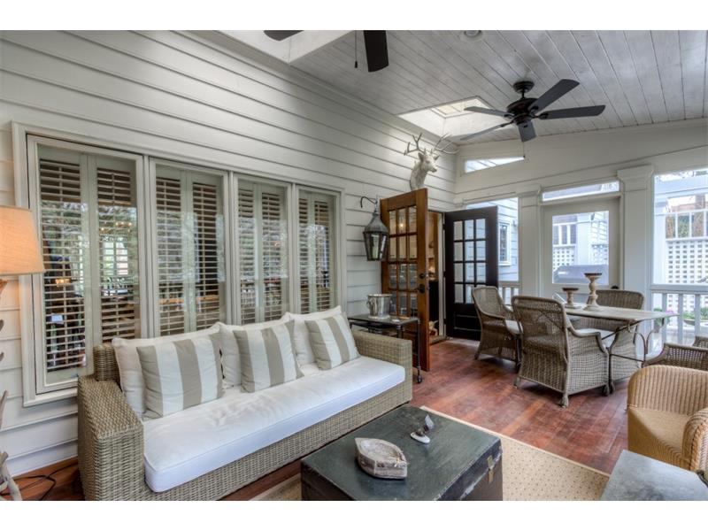 Screened in porch with vaulted ceiling and IPF flooring, 2 ceiling fans and skylights