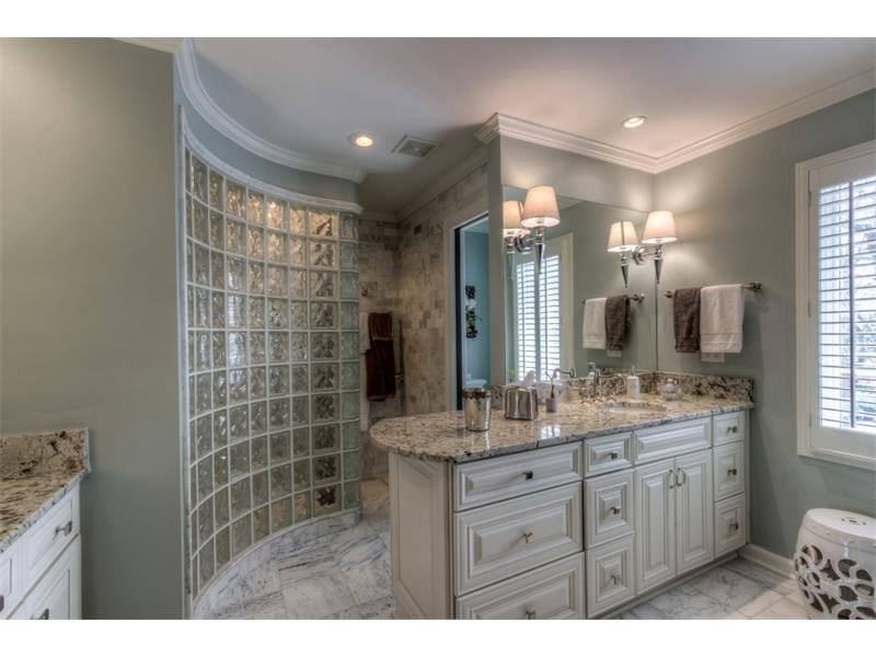 Master spa bath with heated marble floors, oversized shower with multiple spray heads, heated towel rack and 2 vanities and separate water closet.