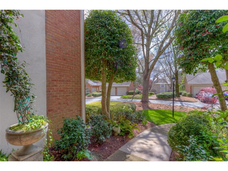 seller's have meticulously manicured the front yard which overlooks the community gardens and offers so much privacy