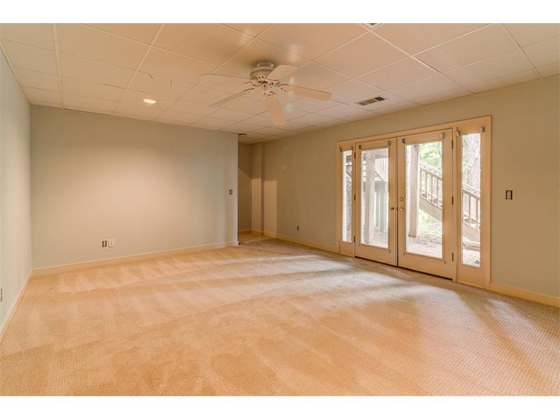 Large recreation room in French doors leading to the patio