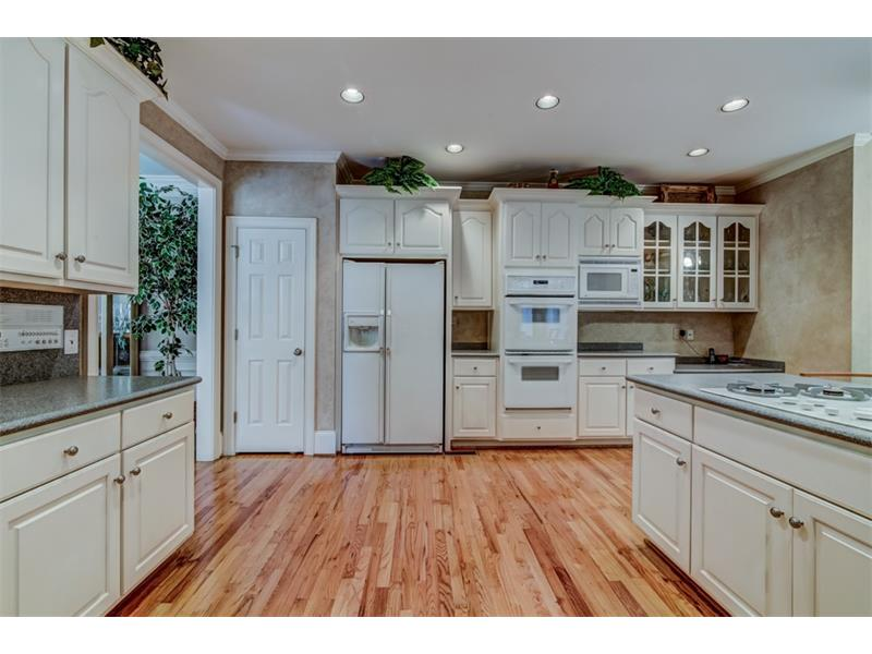 Double ovens and gas cooktop - this beautiful space just needs new appliances