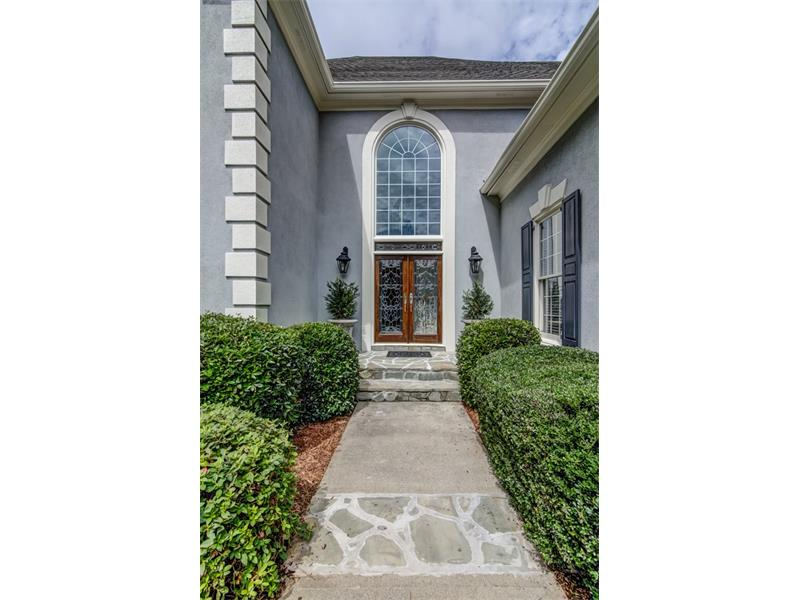 You'll love the stonework on the front walk that complements the front stoop, stone wall at driveway, and the mailbox