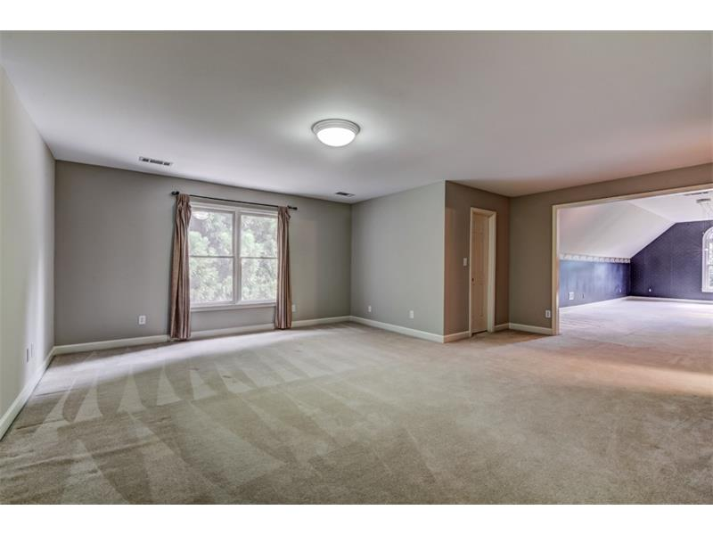 This combination bedroom and huge bonus room could serve as an upstairs master suite and offers so many possibilities