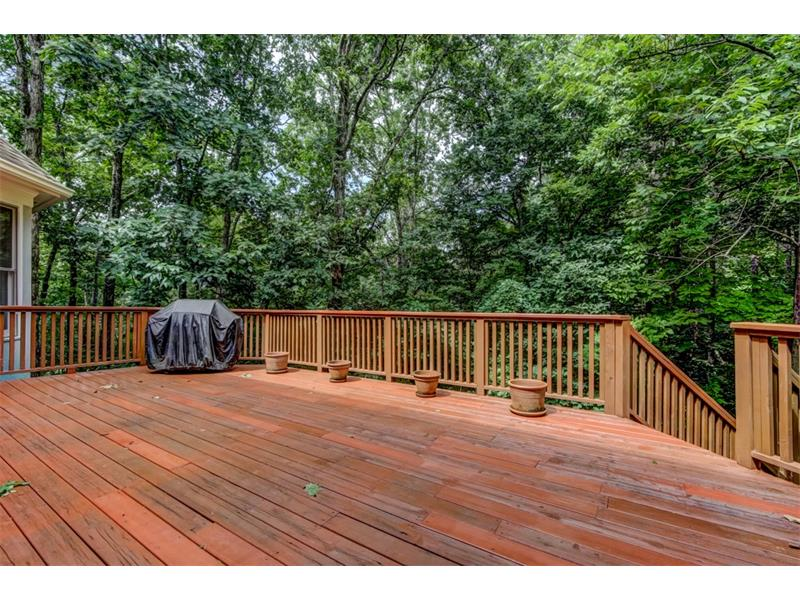 The oversized deck overlooks the private, wooded lot and has stairs leading to a small side yard. A portion of the rear lot is fenced.