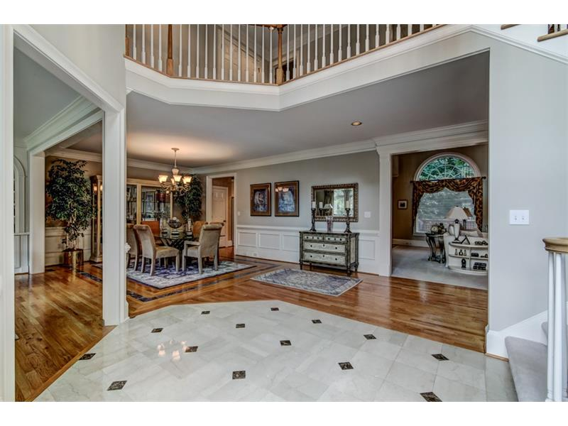 Note the marble tile entry and the open floor plan on the main level
