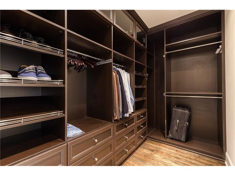 One of Two Custom Closets in the Master Suite