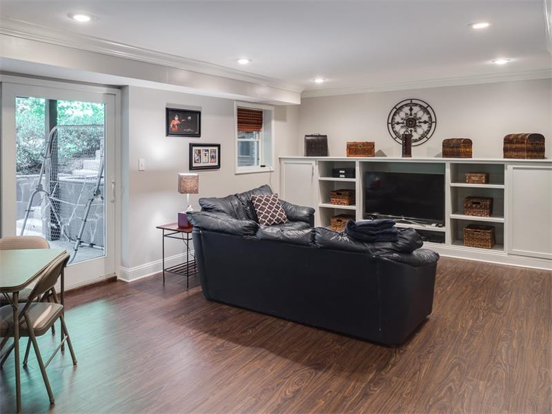 Newly refinished basement with laminate hardwood flooring is perfect play and game area