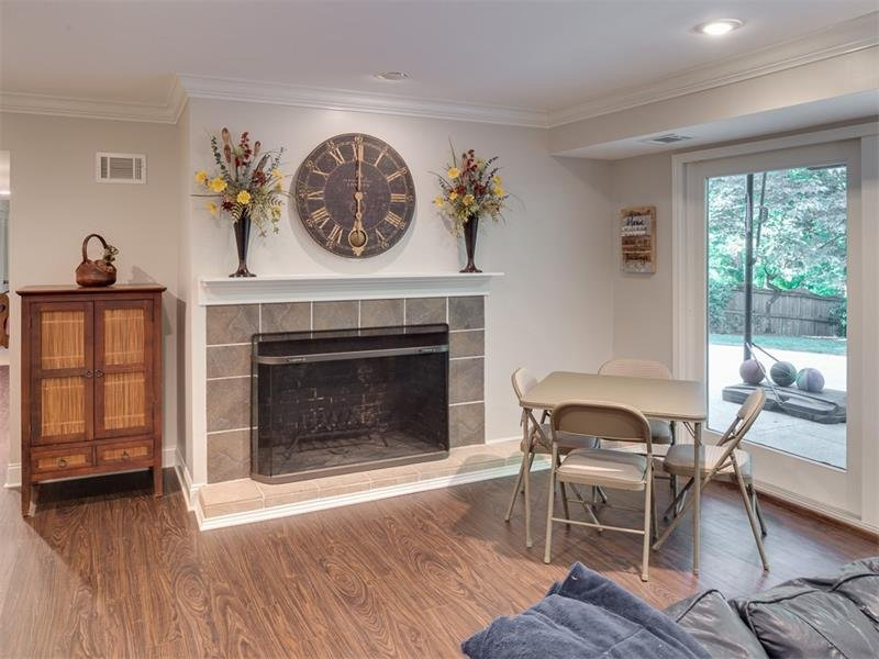 Fireplace makes for cozy entertaining.  Basement walks out to level backyard