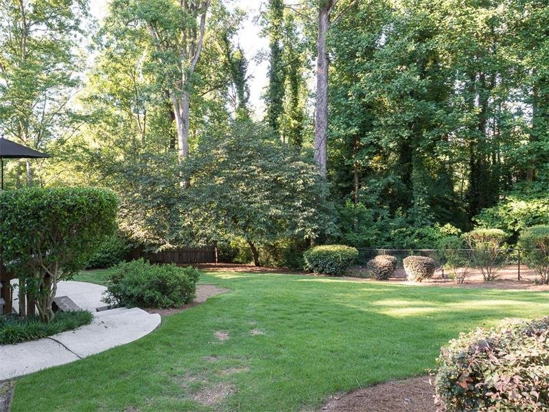 Beautiful backyard with play area is fenced and very private