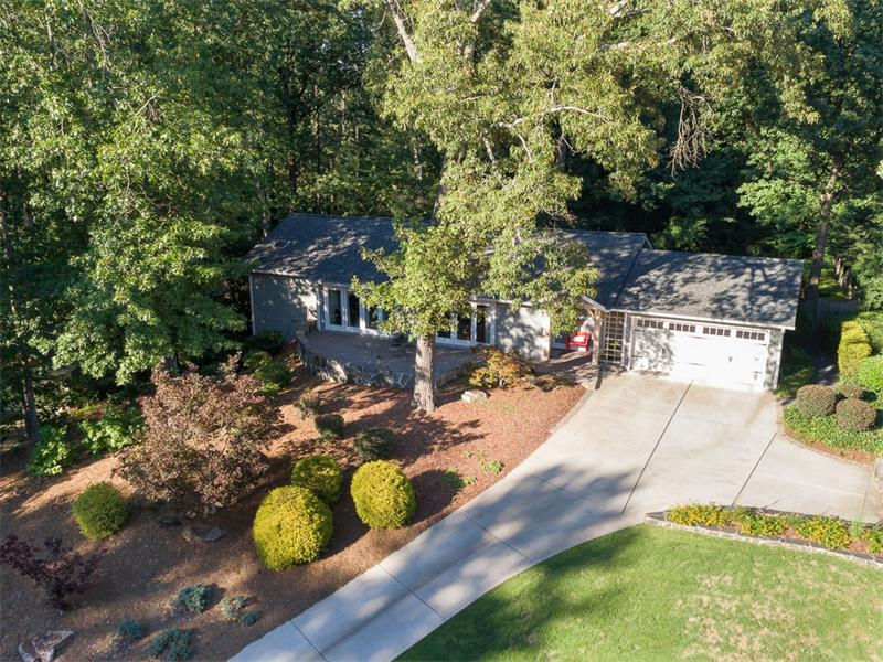Aerial view shows beautiful, wooded lot